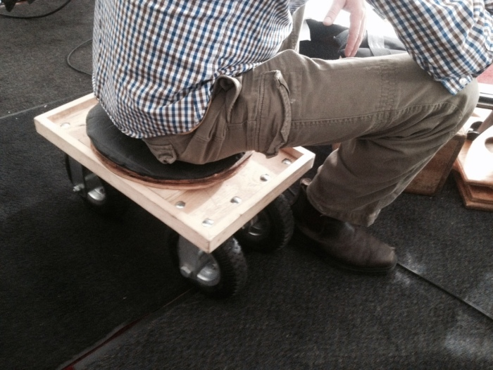 """A """"butt-dolly"""" allows operator, Joe Turner as little more comfort and maneuverability."""