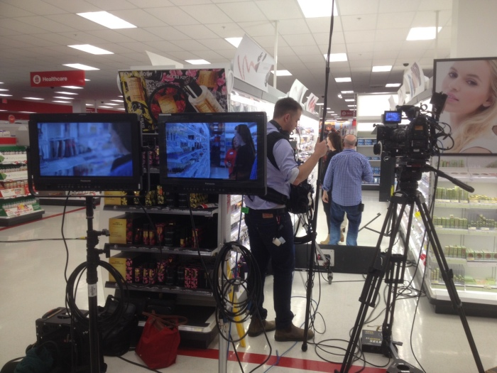 Shooting at Target. Two cameras ready for a scene in an aisle.